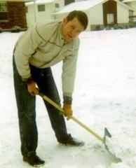 Clayn shoveling snow