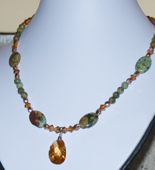 DSC_0001 rhyolite ovals and beads copper swavorski crystals and cz orange pendant en az.jpg