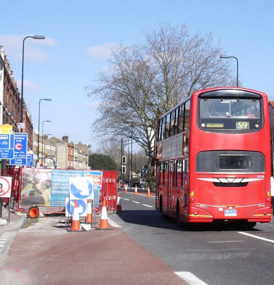 Photo of bus passing Brixton Road roadworks
