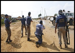 Phomolong township Pretoria cops rubberbullet stonethrowers Mar232010 Lisa HnatowiczBeeld