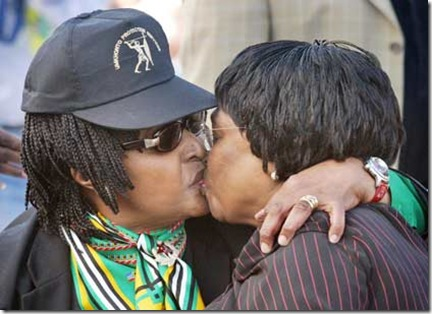 Murdock Alan picture of Winnie Mandela left kissing ex health minister Manto TshabalalaMsimang R