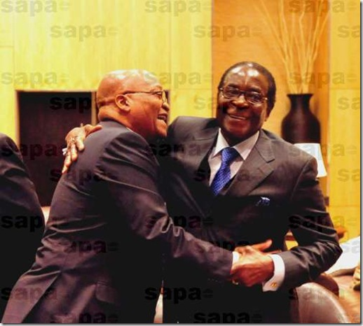 SA pres Zuma and Robert Zimbabwe embrace June 20 2009 SADC summit Joburg