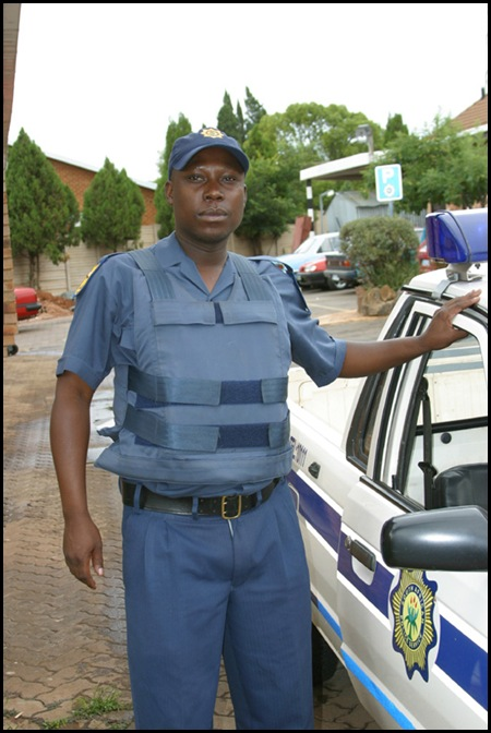 Bulletproof vests used by SAPS pic from official SAPS website the undone zipper is not part of the official dress code