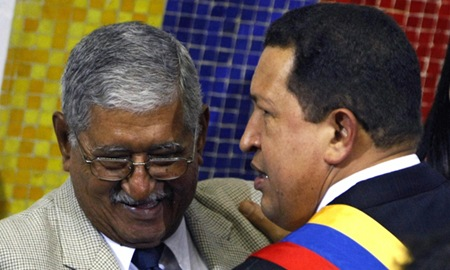 "Venezuelan President Hugo Chavez (R) talks to his father Hugo de los Reyes Chavez (L), at the National Assembly in Caracas, 15 August 2007, during his presentation of a project to modify the Constitution. Chavez prepared to offer Wednesday changes to Venezuela's Constitution to allow the head of state to run for office multiple times and tighten executive control over local government. Chavez wants to modify the Constitution, which was already rewritten under him in 1999, to cement his vision of the ""21st Century Socialism"" and lift term limits that allow the President to serve only two consecutive six-year terms. AFP   PHOTO/Juan BARRETO (Photo credit should read JUAN BARRETO/AFP/Getty Images)"