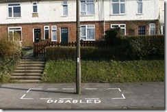 a-council-paint-a-disabled-parking-area-around-a-lampost-pic-dm-574023350