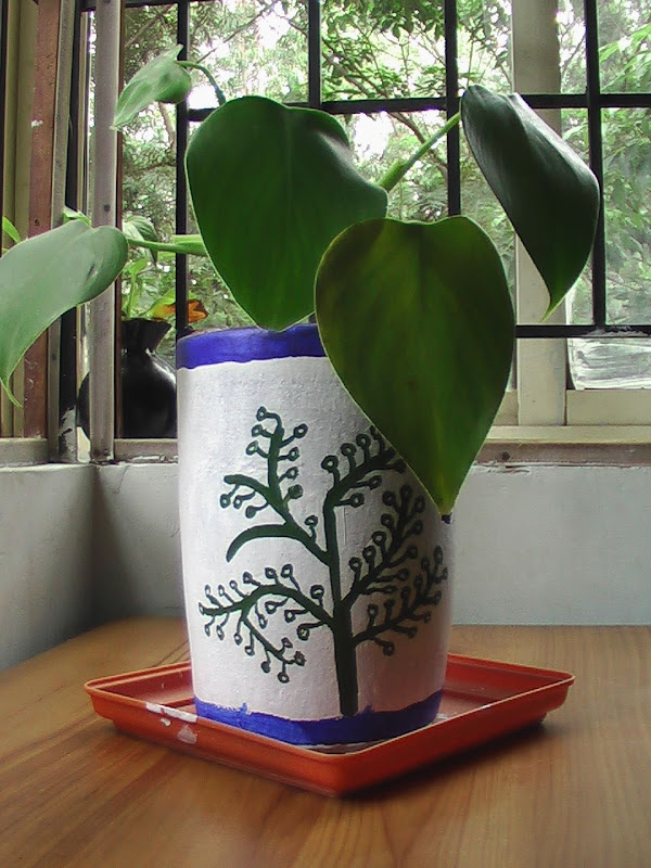 Worli painting on a terracotta planter