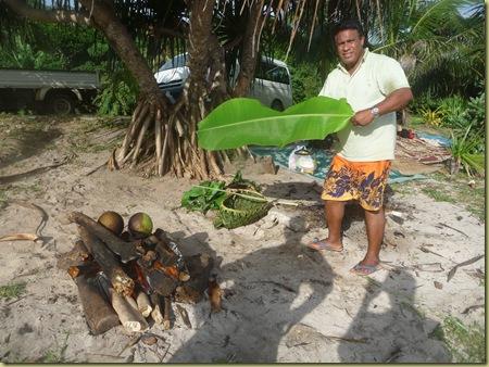 Elder Heimuli grilling breadfruit