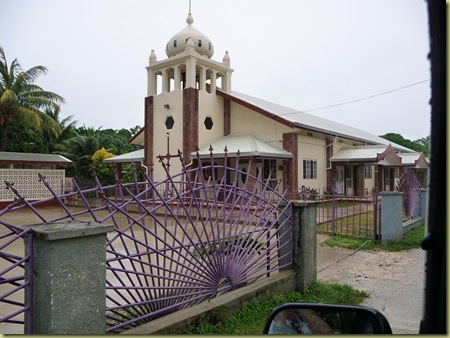 Turn left at the Church of Tonga w/purple fence