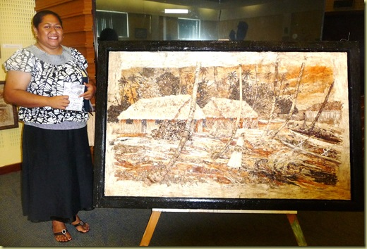 Lavenia and piece of 3-D artwork in door frame