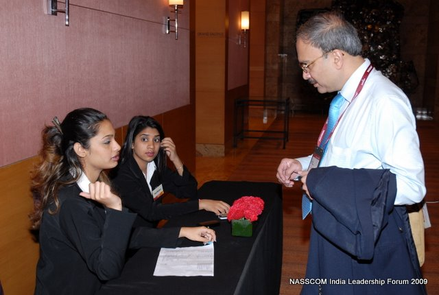 A delegate being assisted at the helpdesk at the NILF 2009 event