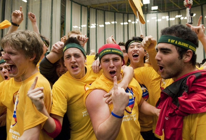 Team yellow celebrates after two thousand and twelve students try to reclaim the Guinness World Record for most people in a dodge ball game, in Edmonton, Alberta, on Friday, February 4, 2011. The record attempt at the Butterdome, Universiade Pavilion on the University of Alberta campus eclipsed the current record which was set by just over 1700 students.  THE CANADIAN PRESS/John Ulan