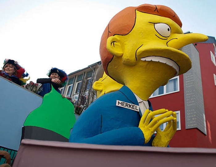 Carnival float representing German Chancellor Merkel is pictured during Rose Monday parade in Cologne...A carnival float papier-mache figure representing German Chancellor Angela Merkel as 'The Simpsons' cartoon character Montgomery Burns, is pictured during the Rose Monday street carnival parade in the western German city of Cologne March 7, 2011. The Rose Monday parades in Cologne, Mainz and Duesseldorf, with their popular floats satirising the year's big news events, are the highlight of the German street carnival season. REUTERS/Alex Domanski (GERMANY - Tags: ENTERTAINMENT SOCIETY)