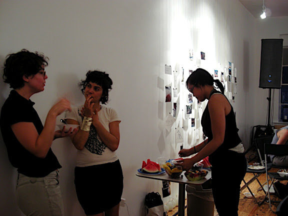 Glenda Reed and Christina Ferwerta talk while Julie Hugh enjoys the lovely fruit platter!