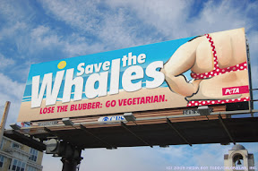 The fatphobic billboard reads: Save the Whales. Lose the Blubber: Go Vegetarian. PETA
