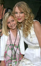 "Taylor Swift and a guest attend the ""Hannah Montana The Movie"" s"