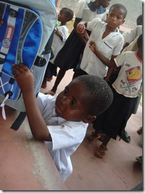Child receiving backpack sm