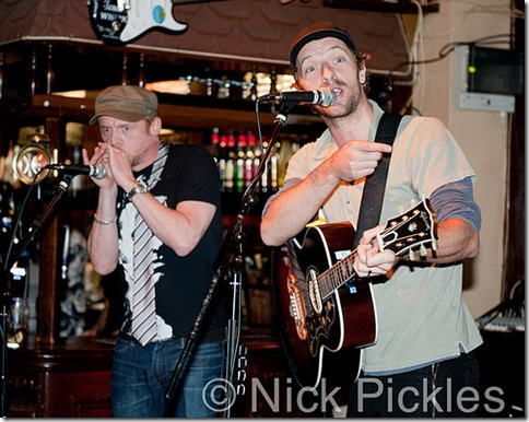 Chris Martin and Simon Pegg play, well, a pub. London, April 2011.