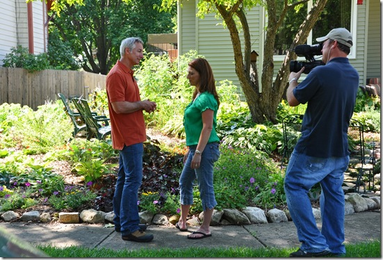 Shawna Coronado and Joe Lamp'l with cameraman taping the garden