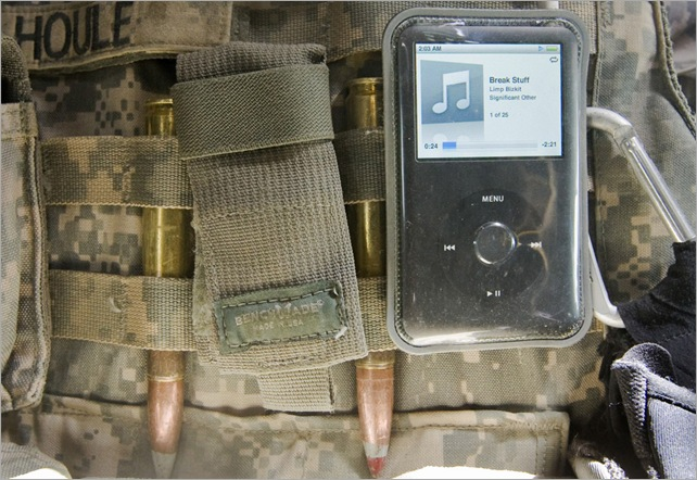 An iPod music player is attached to the tactical vest of a U.S. soldier of 3rd Platoon from the 3rd Brigade, 10th Mountain Division as he drives to the site of a roadside bomb explosion in the mountains of Wardak Province in Afghanistan July 11, 2009. (REUTERS/Shamil Zhumatov)