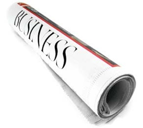 business interview newspaper rolled up