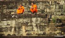 Two Cambodian monks waiting to see the sun set over the old Ankor kingdom from Pre Rup