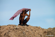 Cambodian man protecting himself from the sun with his scarf at Ton L� Sap, Cambodia