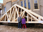 Mason and Madeleine in front of the trusses