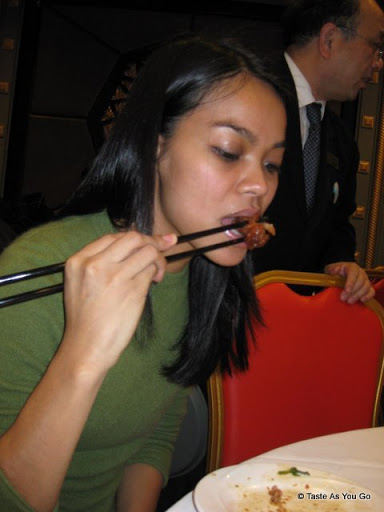 Michelle, Trying a Chicken Foot at Jing Fong Restaurant - Photo by Taste As You Go