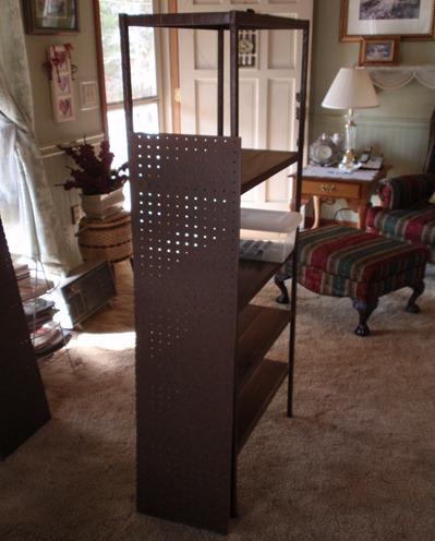 metal shelf with pegboard