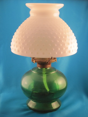green and white oil lamp