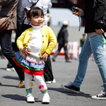 A child poses for her mother in front of the China Pavilion at the Shanghai World Expo site April 25, 2010. The expo started trial operations on Tuesday with the participation of about 70 percent of the pavilions, Xinhua News Agency reported. China is the first developing nation to host the World Expo and officials hope the event, held from May 1-Oct 31, will improve Shanghai\'s position as a global city. REUTERS/Aly Song (CHINA - Tags: BUSINESS SOCIETY)6
