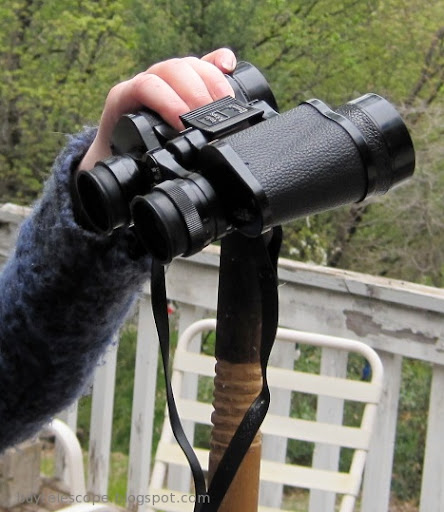 a pair of binoculars held on the end of a walking stick.