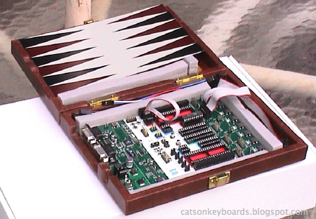 The new STK-500 case with one of the backgammon board pieces that was originally in it.