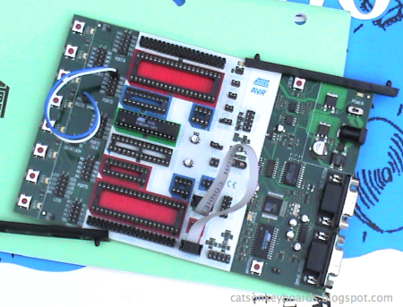 STK-500 board with rails along edge, showing the components are too close to the edge for the rails.