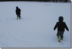boys running in snow