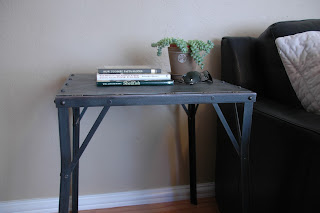 "Inspired from the French industrial era (circa 1940s), this table is constructed entirely of iron and is riveted together for a rugged industrial / retro look. It looks vintage but not beat up. The top measures 20"" x 18"" and it is 26"" tall making it ideal to use as a side table or an accent table. Priced at $275, contact us at 602-322-1111 for more information."