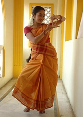 kollywood-actress-maya-unni-in-orange-saree_actressinsareephotos_blogspot_com_002