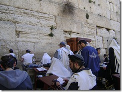 Men Praying At Wall