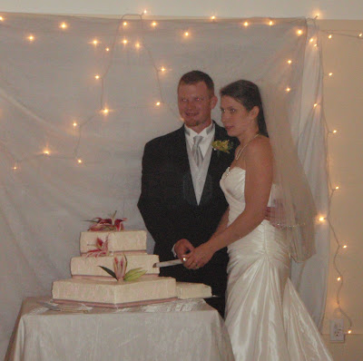 Stephen and Bianca cutting the cake