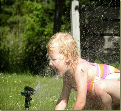 nevaeh in sprinkler