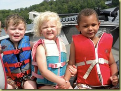 3 kids in boat