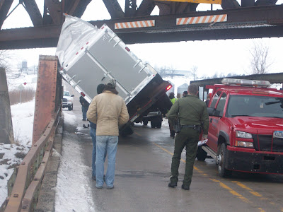 Crews assess the situation at the overpass on old 92, just outside Washington on Thursday January 14, 2009. This tractor trailer was too tall to fit under the overpass (KCII NEWS)