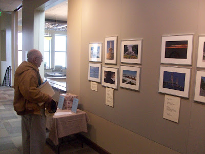 "A patron at the Washington Public Library looks at the ""Great Lakes Region"" Photo Exhibit now on display in the Helen Wilson Gallery - KCII News"