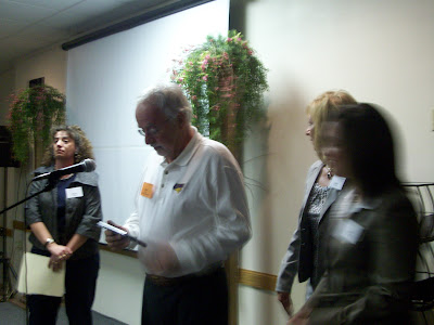 Ted Drain (White Shirt) accepts the Main Street Volunteer of the Year Award on behalf of hist late Wife Mary Ann (KCII NEWS)