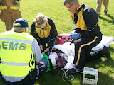 Crews from Aircare and other emergency officials strap in the mock vicitm