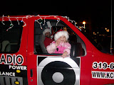 Emma Nichols waves to the KCII news team as dad and KCII General Manager Joe Nichols pilots the Big Red Radio through Washington's 15 annual Lighted Holiday Parade (KCII NEWS)