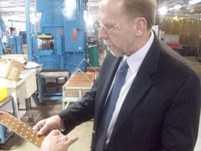 Congressman Dave Loebsack (D-Iowa 2nd District) inspects a component at the Modine Plant in Washington 12/22/09 (KCII NEWS)