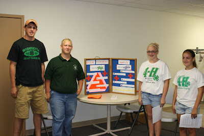 4-H members with their Rural Roadway Safety Display, members are Ty Sexton, Kyle Huber, Jacqueline Spenner and Shari Temple.<br /> (Washington County 4-H)
