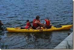 Diane taking kids in the boat