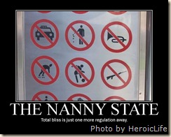 "Close up of sign with prohibition symbols captioned ""THE NANNY STATE Total bliss is just one more regulation away."""